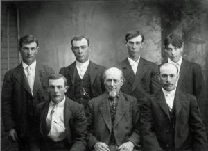 Albert Dickerson and his six sons, probably around 1920. (Ida May, not pictured, was his only daughter with Anna.) Top row: Charlie, George, Ernest, and Ed. Bottom row: Will, Albert, and John.