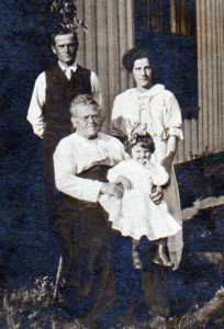 Esther holds granddaughter Emlyetta in a photo with her son's family: Alwyn Eggleston, and his wife, Clara.
